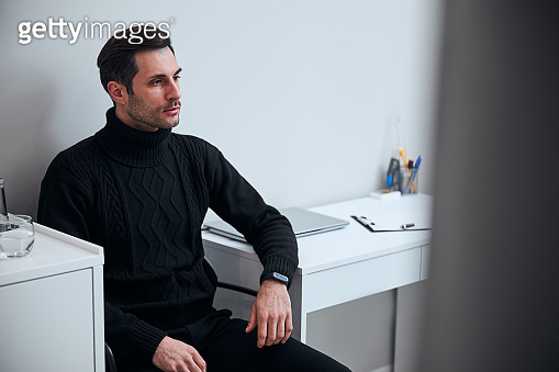 Handsome young man coming to modern clinic