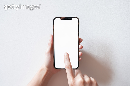 Smartphone mockup. Businesswoman hand using phone white screen. Isolated on white background.
