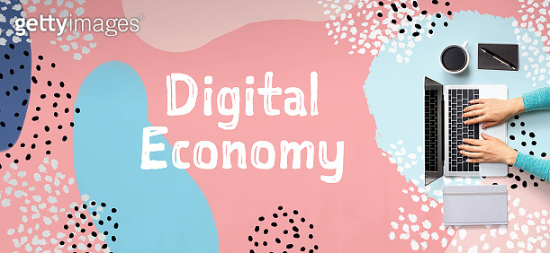Digital economy concept with person using laptop