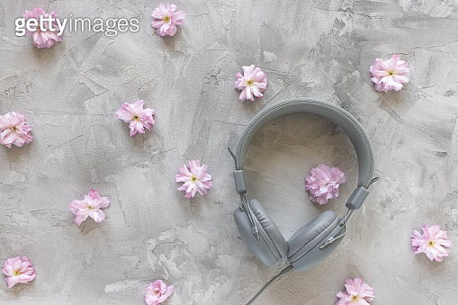 Headphones on gray spring or summer background