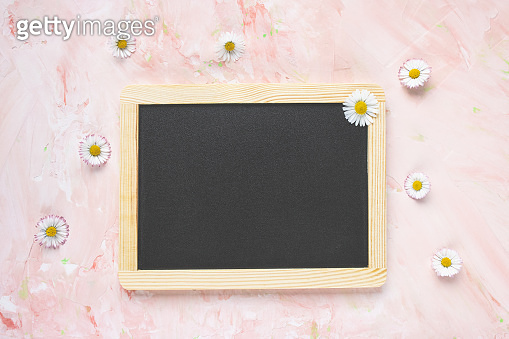 Empty message black board and fresh spring flowers