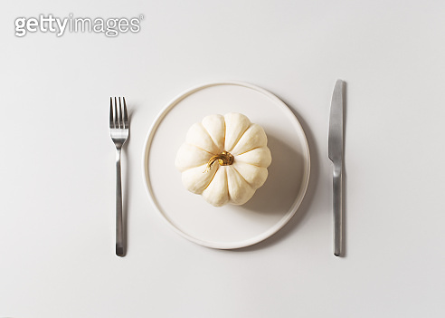 Thanksgiving, harvest and halloween setting table on white
