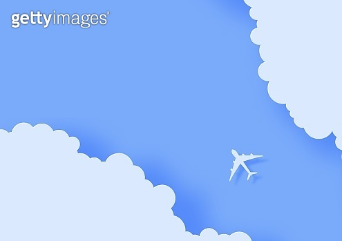 Silhouette of a passenger plane flying in the sky in paper cut style. 3d cut out of cardboard clouds and airplane in blue sky. Top view origami landscape. Vector travel illustration concept.