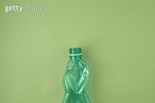 flat lay with plastic bottle isolated on green background