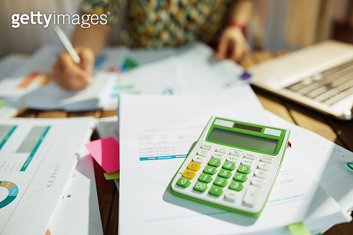 Modern accountant woman working with documents in office