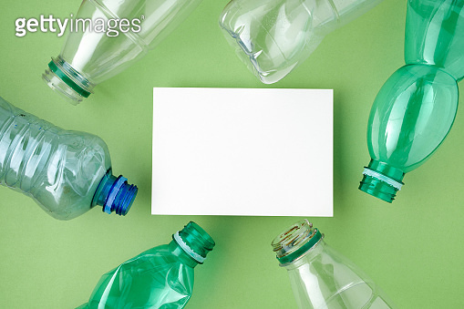 flat lay with plastic bottles isolated on green background