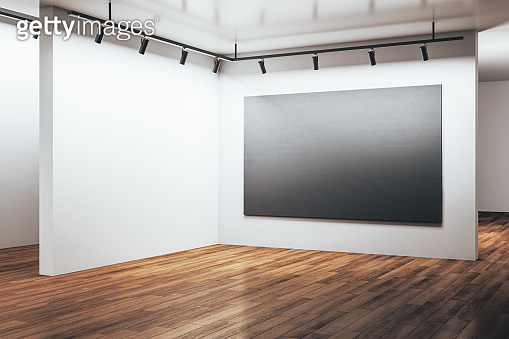 Luxury gallery hall with empty black poster on wall.
