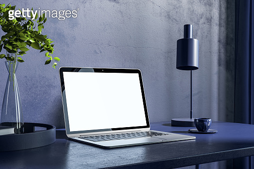 Close up of blue office workplace with empty laptop and other items. Hipster home workplace. Mock up, 3D Rendering.