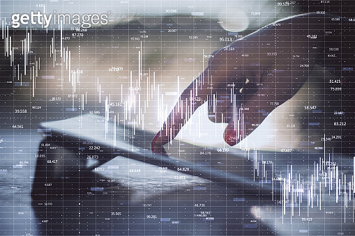 Businessman hand using tablet with crash recession chart