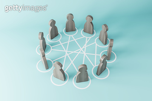 Communication and social network concept with human dark wooden figures standing in a circle on light blue background