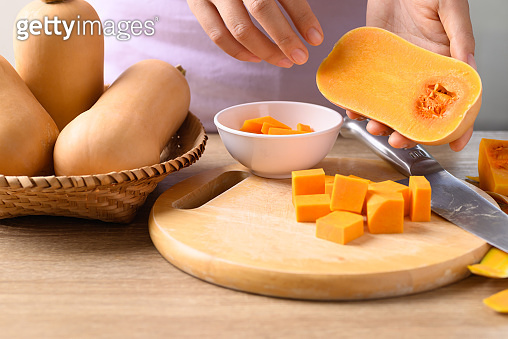 Woman hand cutting butternut squash prepare for cooking