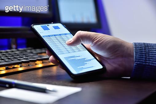 Accountant hand using mobile phone