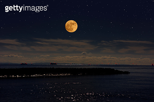 Full moon rising over the Tokyo bay area