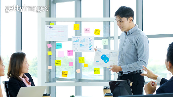 Businessman presenting business plan information at office meeting, Asian man explaining business chart, business people, success in business concept