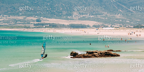 Tarifa, Spain. People Surfing and resting at beach. Tarifa is most popular places in Spain for surfing And vacation
