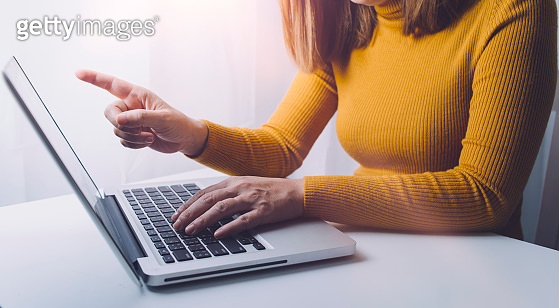 Woman using a laptop with World and big data network connection, World Wide Web, social network