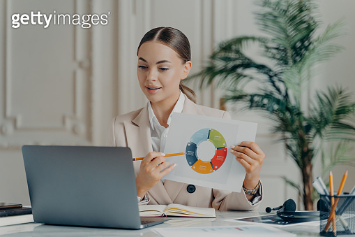 Female economist showing statistical data during meeting