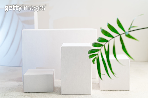 Scene with geometrical forms white background. Geometrical podium, pedestal empty stands. Background for cosmetic products. Showcase, product presentation, advertisement concept