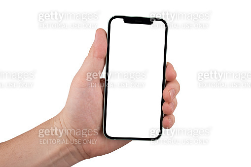iPhone 12 green against white background. New smartphone from Apple company in hand close-up.