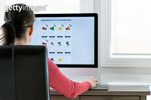 Woman Grocery Shopping Online on her Computer from Home
