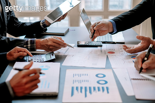 Business people brainsto ideas for business investment strategies, charts and documents for business.