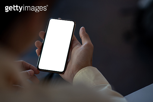 Close up. businessman holding mobile phone white blank smartphone screen. mock up. copy space.