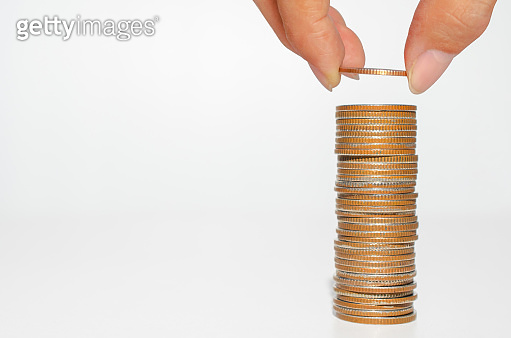 business man hand put coin stack growth up isolated on white background. money saving, financial growing, business startup, economy budget and investment concept.