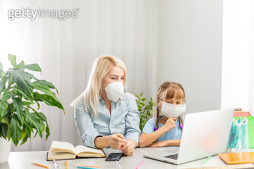 Business Woman and child wear sanitary masks Work at home To prevent the corona virus