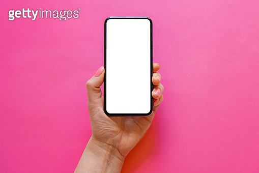 Mobile phone with empty white screen in hand on bright pink background