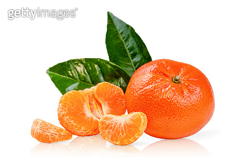 Composition of clementines or mandarines with green leaves isolated with clipping path on white background.