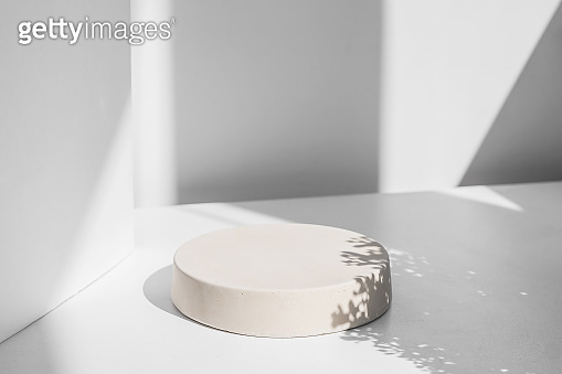 Abstract minimal scene with geometrical form. Cylinder podiums in white colors. Abstract background. Scene to show cosmetic podructs. Showcase, display case. 3d render