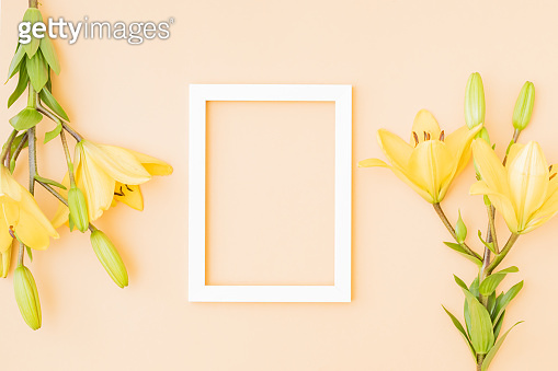 Mockup with a white frame and yellow lilies on color background