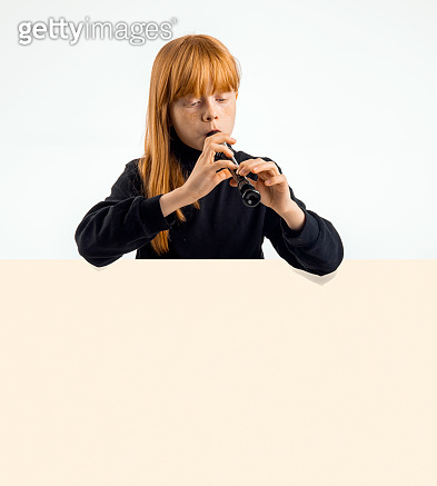 Beautiful girl playing the flute