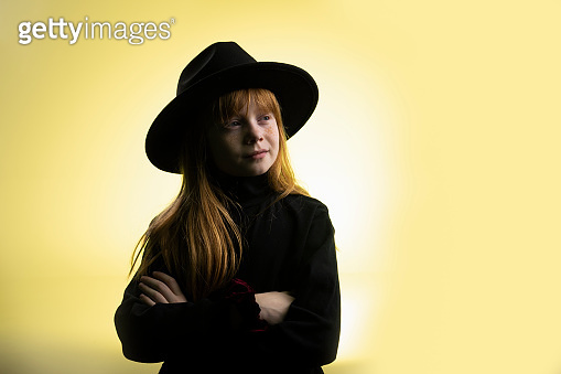 Confident little girl with hat