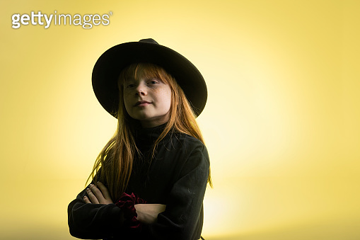 Beautiful young girl wearing a hat