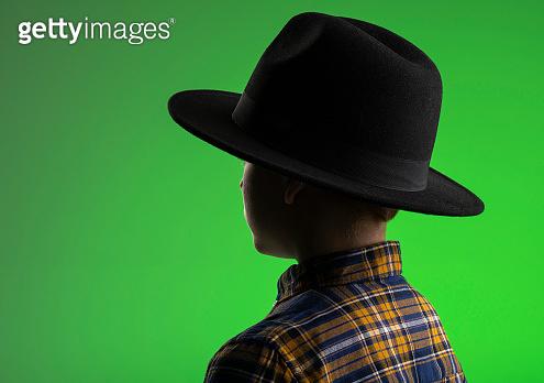 Rear view of boy in hat