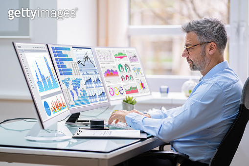 Man Advisor Using Multiple Computer Monitors