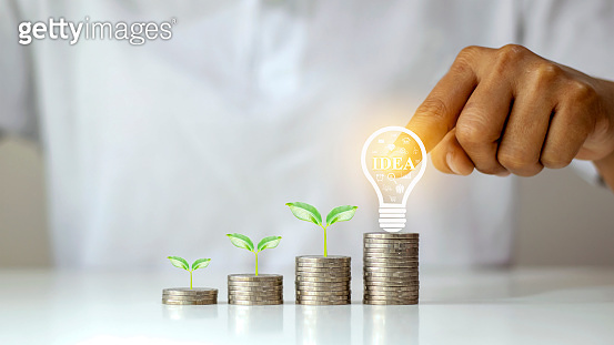 Trees grow on coins and bulbs, creativity on coins, money growth ideas and business investment systems.