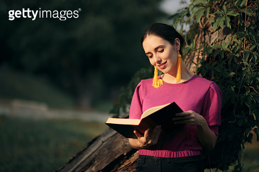 Elegant Woman Reading a Book Outdoors