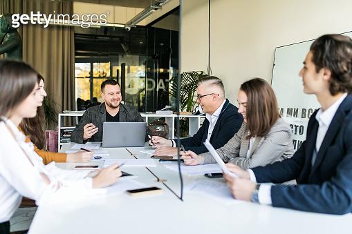 Business people having board team meeting in modern office