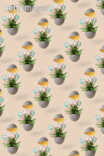 Pattern of Easter broken egg with tulip flowers on pastel yellow background.