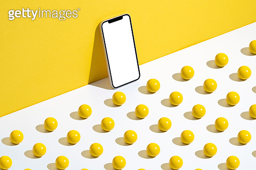 Smart phone mockup, template with yellow wooden balls