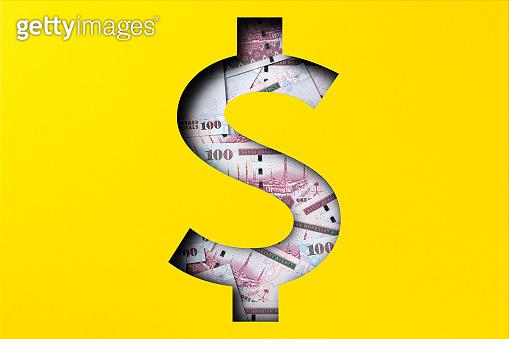 Money heap under paper cutout dollar icon, Saudi riyal
