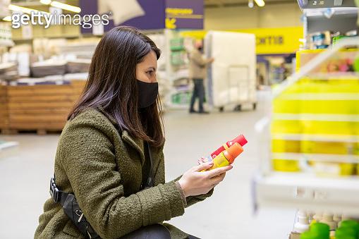 woman in store choosing stuff