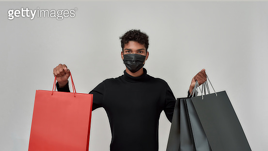 Young african american man in protective mask