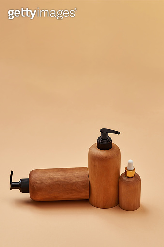 Set of wooden containers of different sizes isolated on beige background. Zero waste and eco conscious life