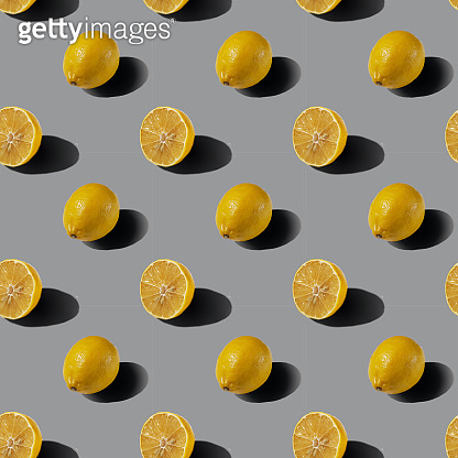 A pattern of whole lemons on a gray background. Healthy food concept. Flat lay.