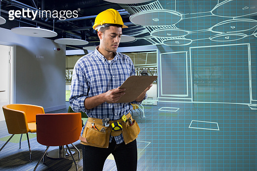 Composite image of concentrated construction worker