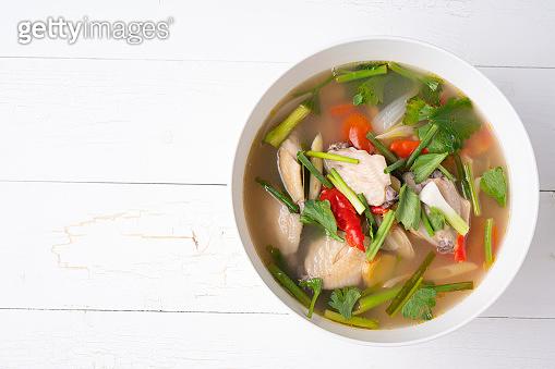 Thai Spicy chicken clear soup , tom yum kai,