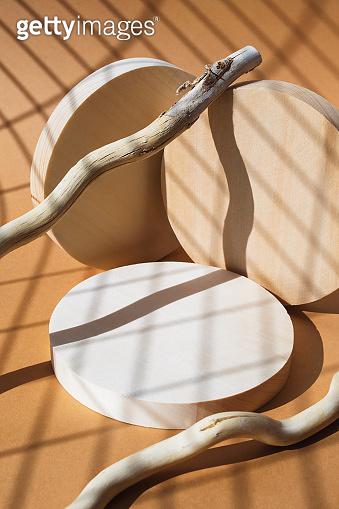 Thtee round podiums on natural beige background. Round wooden slab product presentation stages